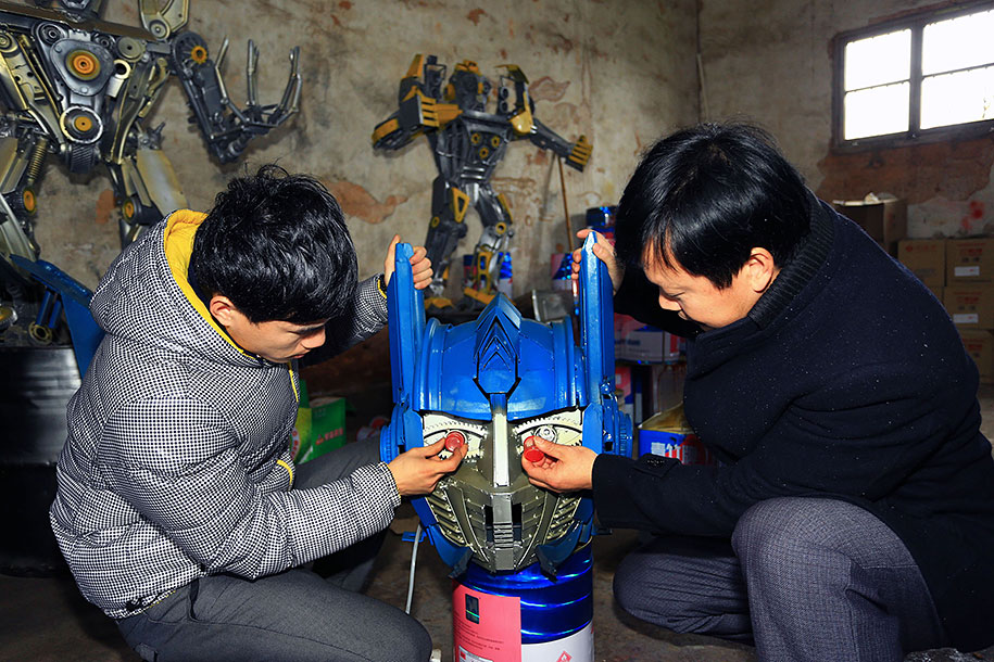 recycled-car-parts-scrap-metal-sculpture-transformers-father-son-farmer-china-05