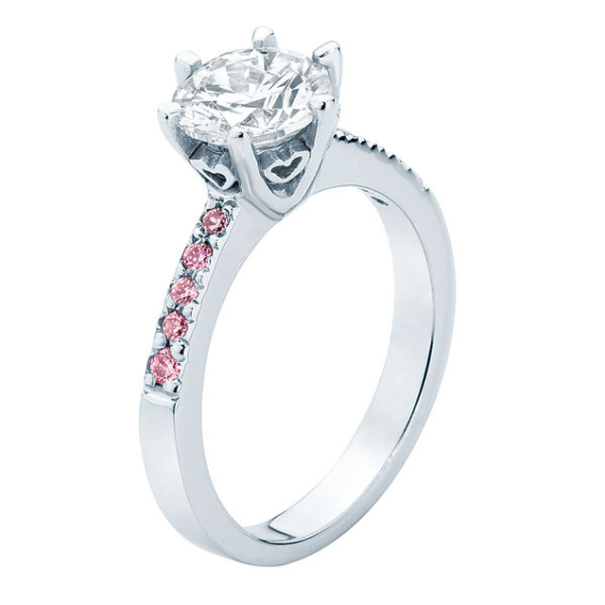 The 'Ava' featuring a round brilliant diamond offset with beautiful Pink Sapphires