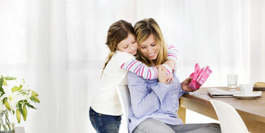 Child giving mom a hug