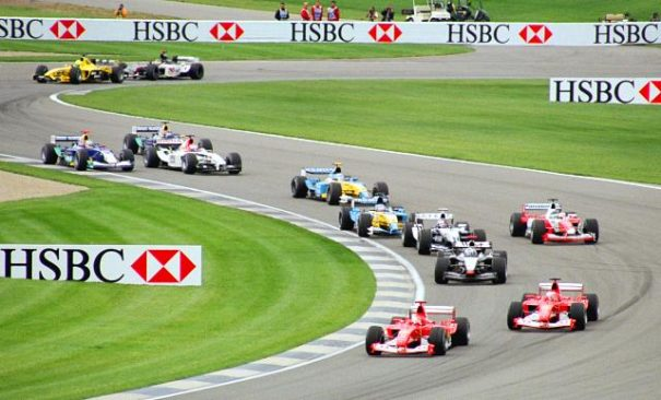 Formula One cars wind through the infield section of Indianapolis Motor Speedway at the 2003 United States Grand Prix