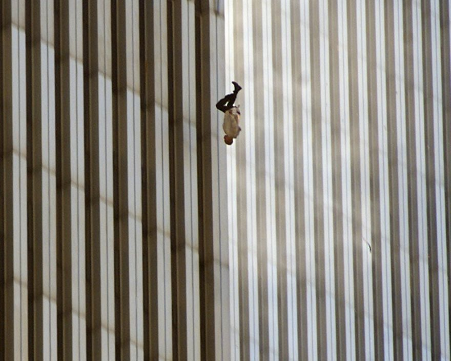 SEVENTH IN A SERIES OF ELEVEN-- A person falls from the north tower of New York's World Trade Center Tuesday Sept. 11, 2001after terrorists crashed two hijacked airliners into the World Trade Center and brought down the twin 110-story towers. (AP Photo/Richard Drew)
