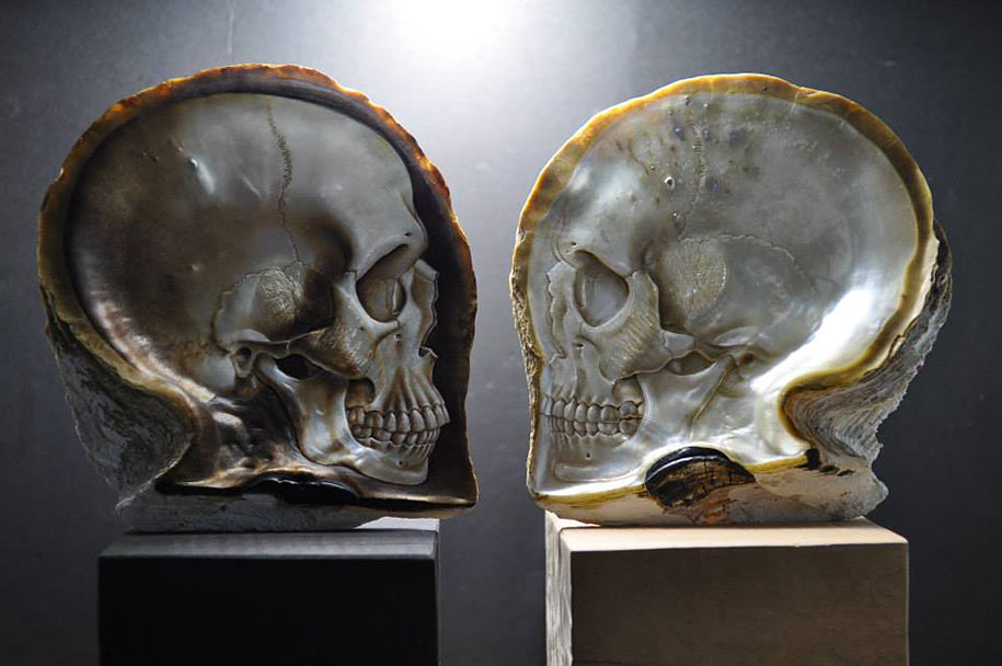 Beautifully realistic skulls carved into mother of pearl