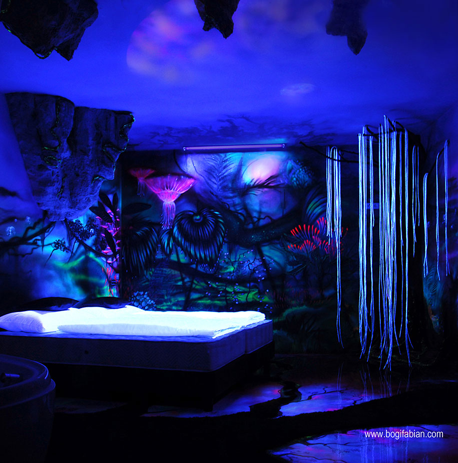 artist paints rooms with murals that glow under blacklight artist paints rooms with murals that glow under blacklight
