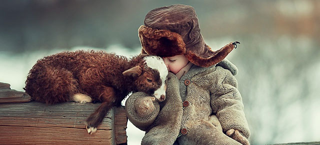 Russian Photographer Captures Adorable Photos Of Animals And Kids Playing In Snow