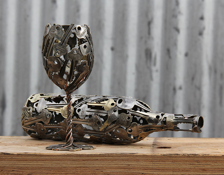 artist transforms old keys and coins into beautiful art