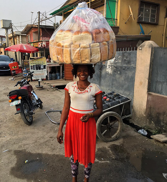 nigerian-bread-seller-modeling-contract-photobomb-olajumoke-orisaguna-4