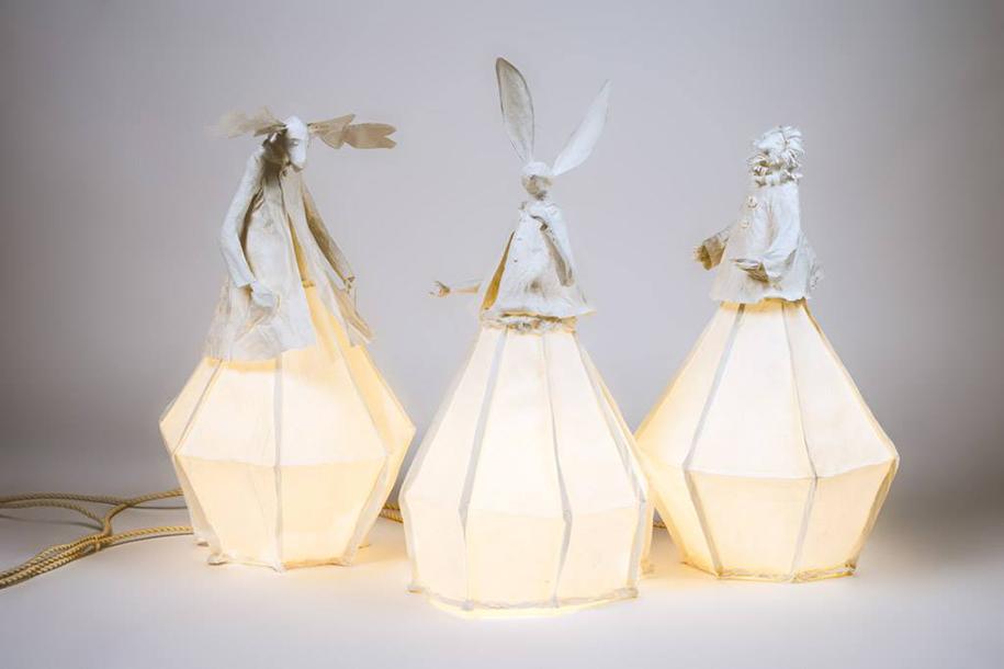 elegant paper lamp sculptures illuminate the room with style