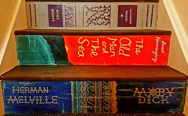 Do it yourself demilked woman paints staircase with the covers of her favorite books solutioingenieria Image collections