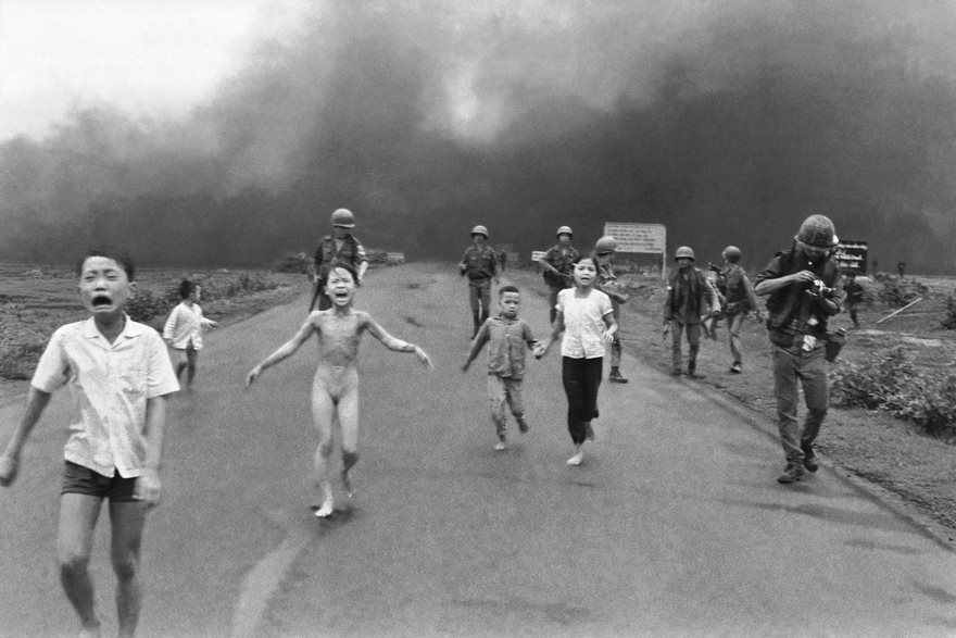 South vietnamese forces follow after terrified children including 9 year old kim phuc
